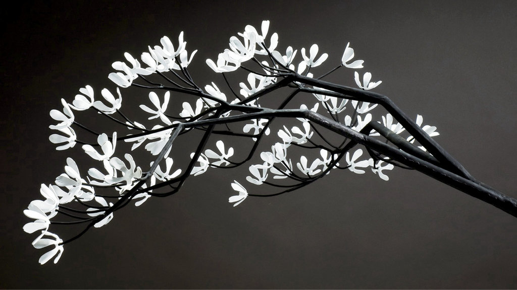 Blossoms and branches on the Sarviceberry Tree clock.