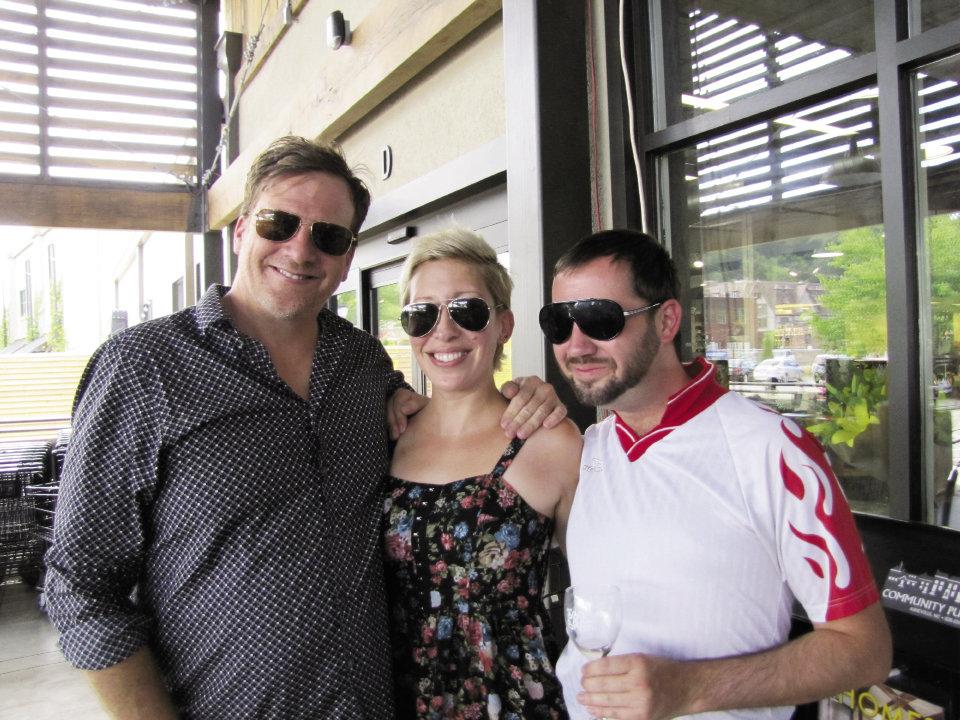 Asheville Grit's Ayana Dusenberry with Doug Hecker (left) and Chris Bubenik