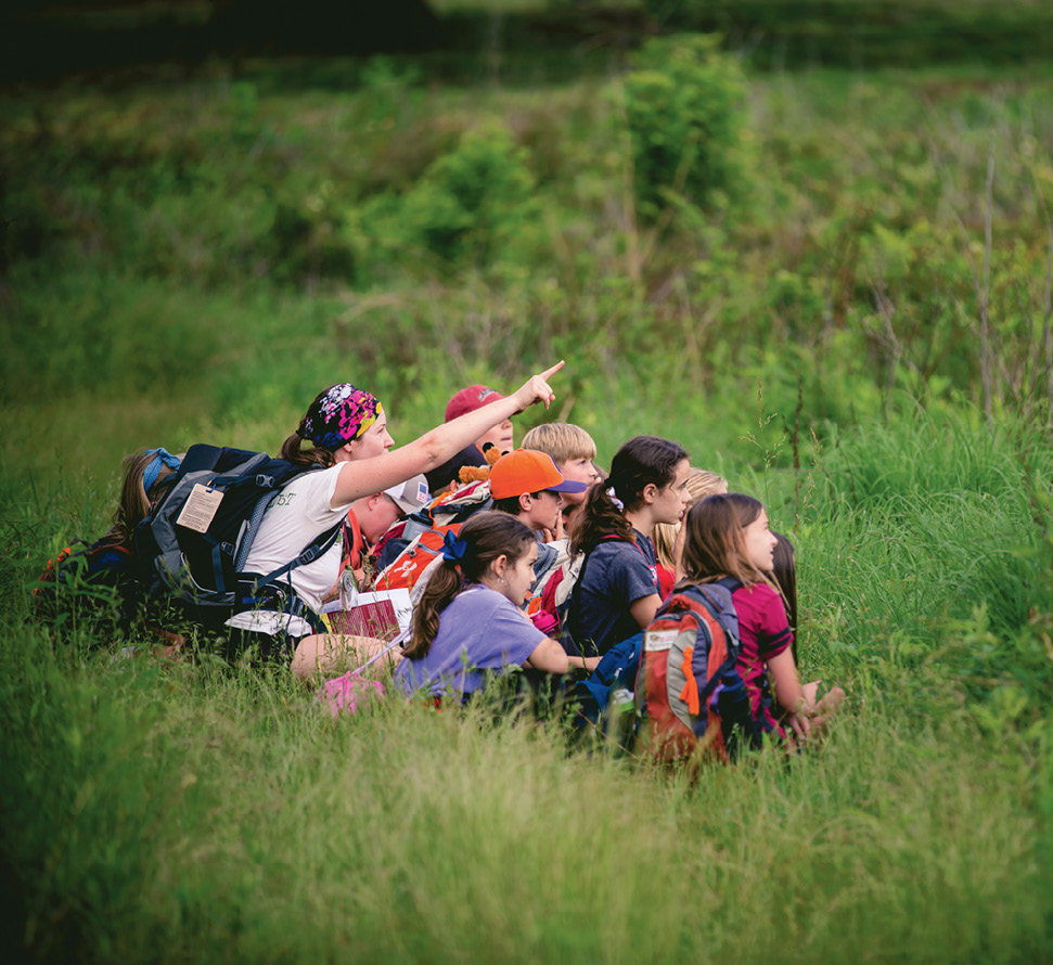 Outsiders: During an Ecosystems Interactions study, a group from Augusta Circle Elementary in Greenville, South Carolina, led by instructor Carlisle Rankin, peers at birds at Bunched Arrowhead Preserve.