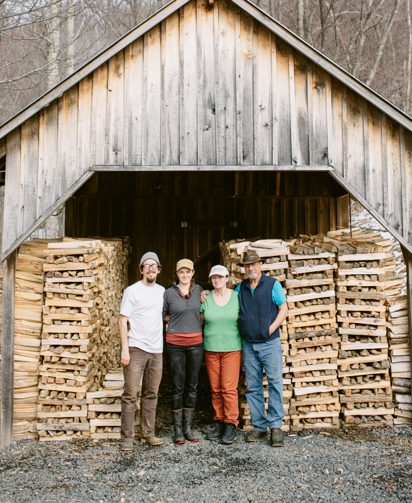 From left, Michael Waldeck, Wheeler Munroe, Nancy Roten, and Doug Munroe work as a team to produce maple syrup at Waterfall Farm.
