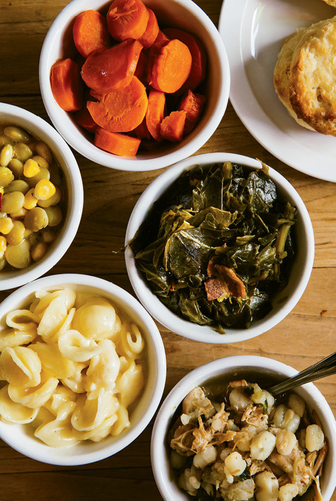 Diners can choose from among 15 sides, including glazed carrots, succotash, collard greens, mac and cheese, and posole, a Mexican soup with hominy.