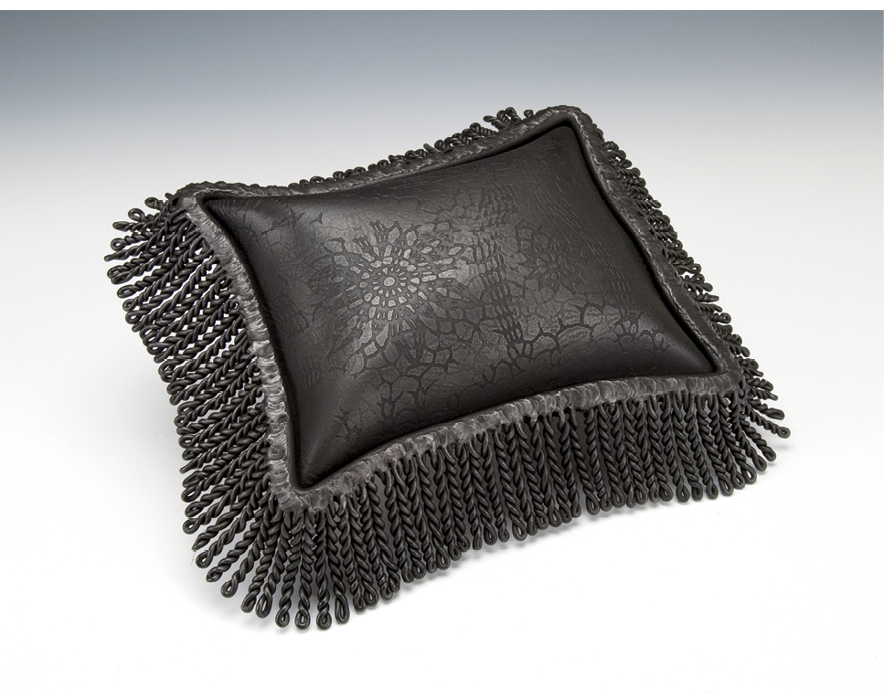 """One of a Kind - To make this pillow, titled Gothic, Brim used a technique she developed and calls """"inflation,"""" by which compressed air is injected between two sheets of welded steel."""