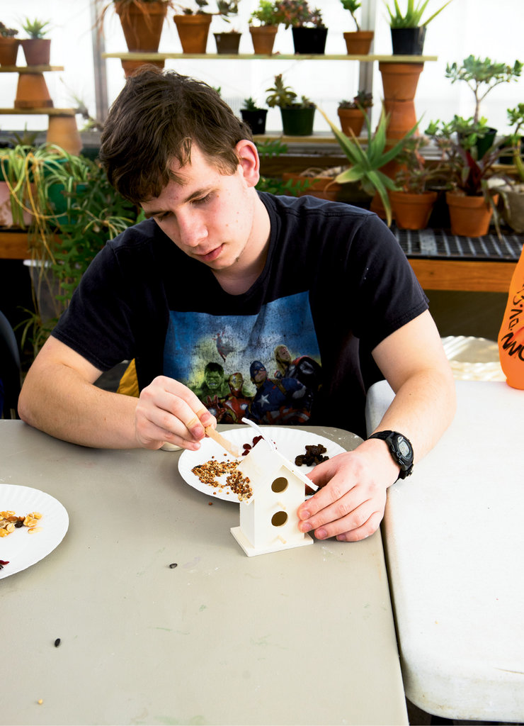 Growing Power Volunteers work with disabled young adults, including Sergey Silvers (pictured), who gain confidence and communication skills through garden activities.