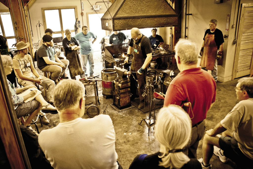Instructor Jeff Mohr (center) got his start in blacksmithing as a student at the school 30 years ago.  In his Home and Hearth course, he shares forging techniques for making fireplace accessories, gates, furniture, and more.