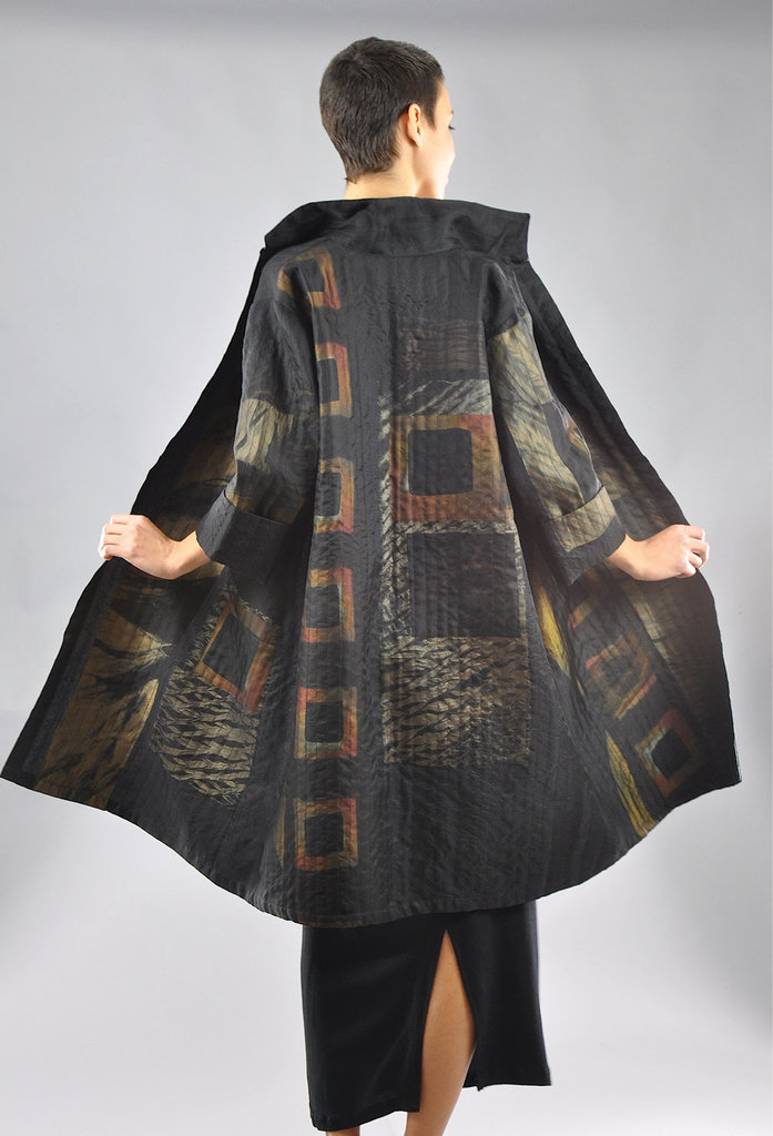 A multilayered swing coat features silk shibori pieces and channel stitching.