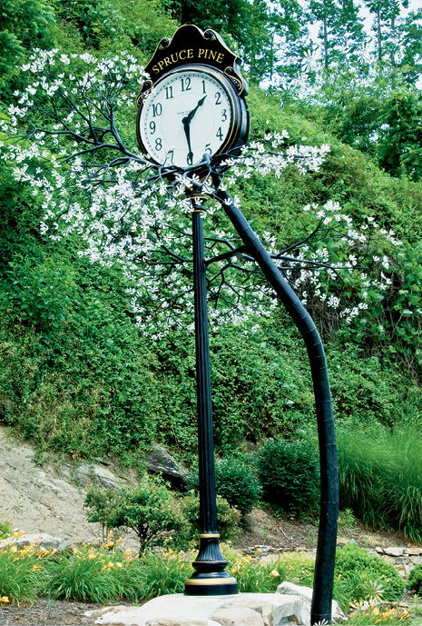 Branching Out - Residents of Spruce Pine helped Brim complete the Sarviceberry Tree clock, along with its blossoms and branches, that stands in downtown.