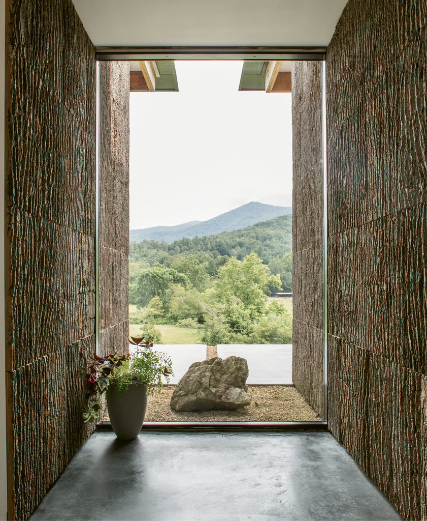 Zen Greeting: The entry, clad in bark harvested in Barnardsville, carries nature indoors and frames a spectacular view of peaks in the distance.