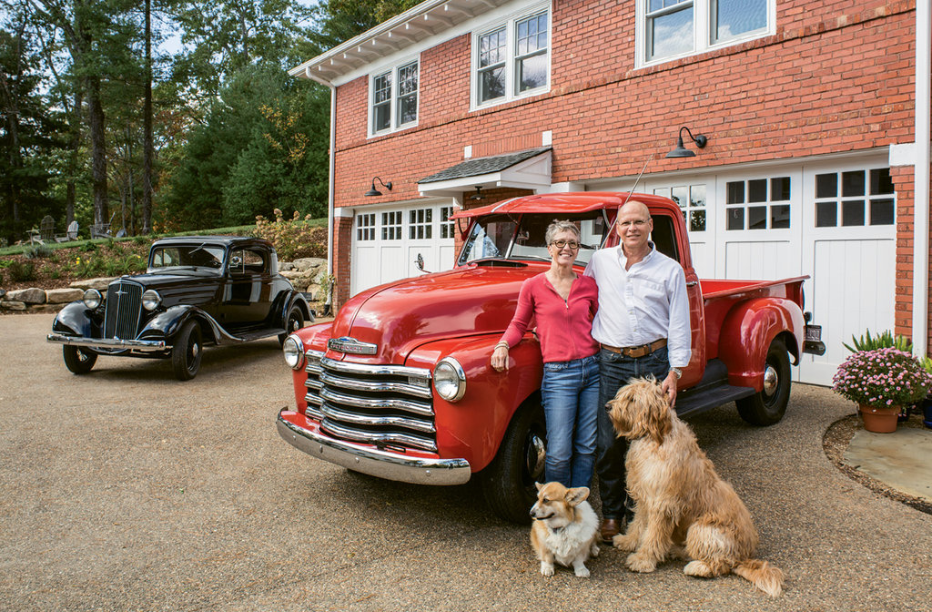 The detached carriage house, which houses the couple's antique cars and an upstairs apartment, was renovated first to accommodate Carole and Cole and their pups, Baxter and Scout, while the main house underwent extensive work.