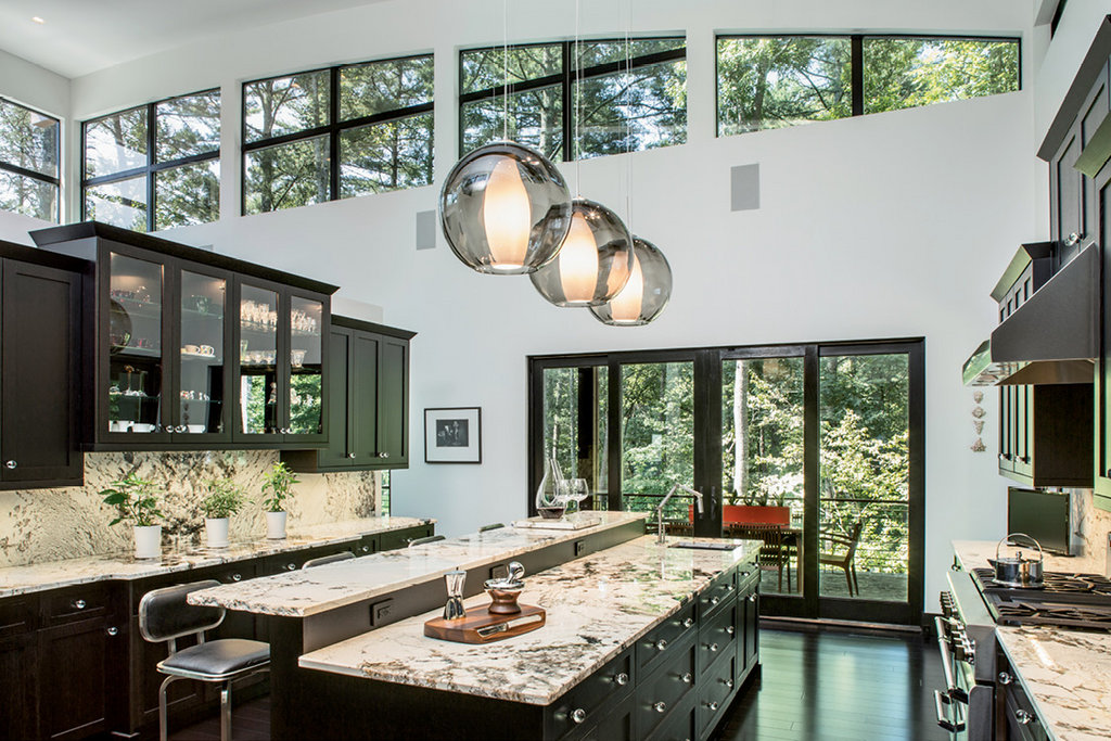 The kitchen, a replica of the one the couple revamped at their old house, features custom cabinetry and granite countertops.