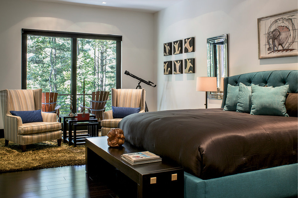 The bedroom, with access to the back deck, and a separate walk-in closet complete the 700-square-foot sanctuary.