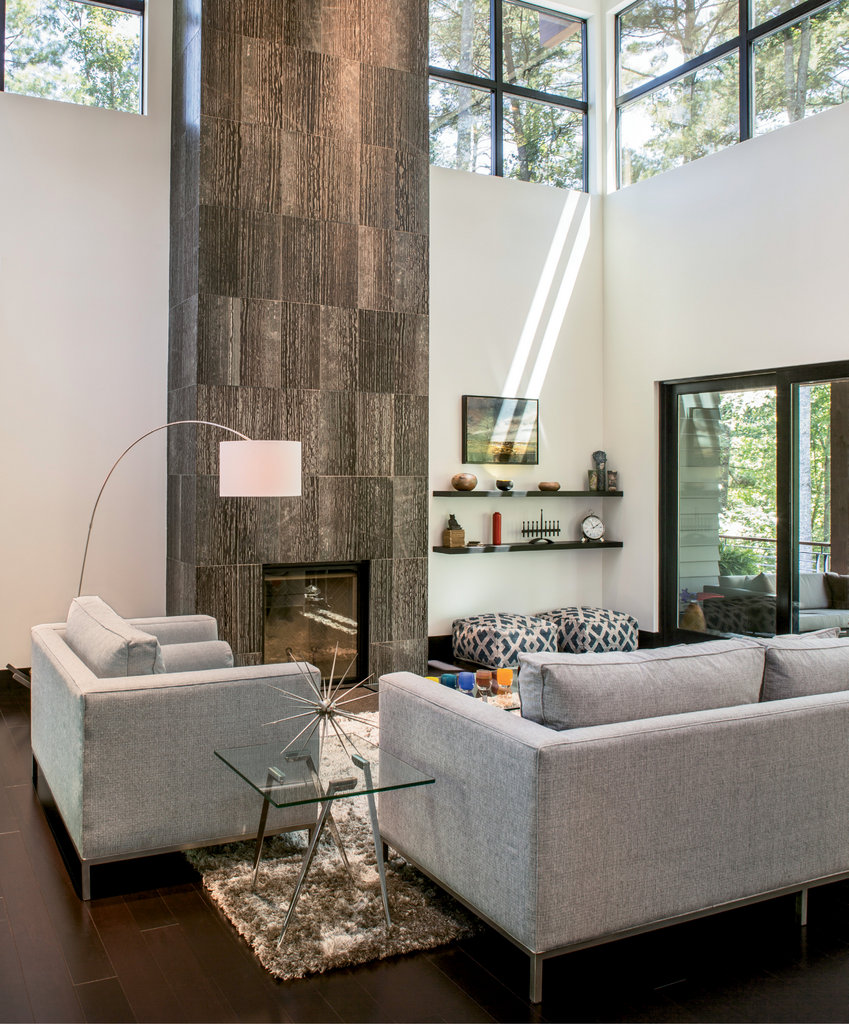 In the great room, clerestory windows allow in ample light. The floor-to-ceiling marble fireplace and inviting views through large sliding glass doors vie for attention.