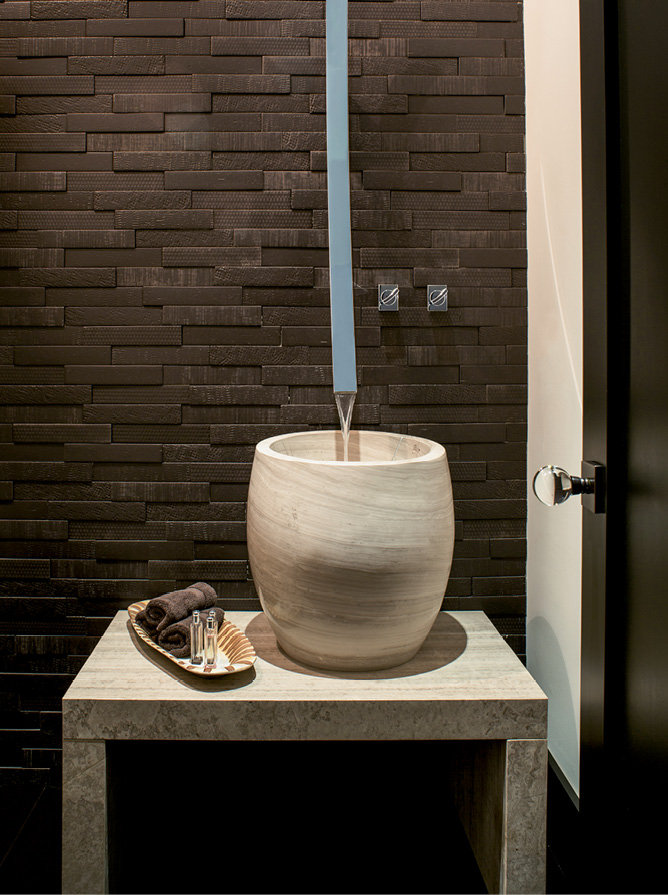 The sleek, modern hardware in the half bath was purchased from a store in Fort Lauderdale.