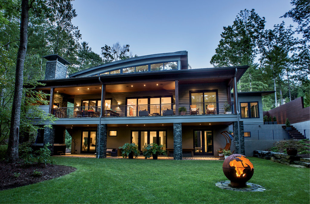 A metal Earth fire pit draws guests outside, while 1,575 square feet of covered porch and patio hold an outdoor kitchen, ample seating areas, and a hot tub.