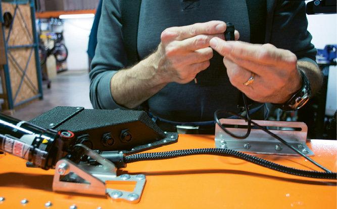 Carl Mersch assembles a connector.