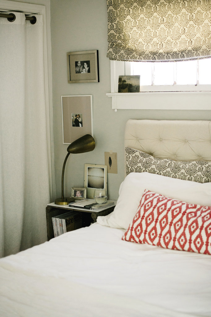 She crafted the tufted linen headboard to complement the soothing tones in the master bedroom
