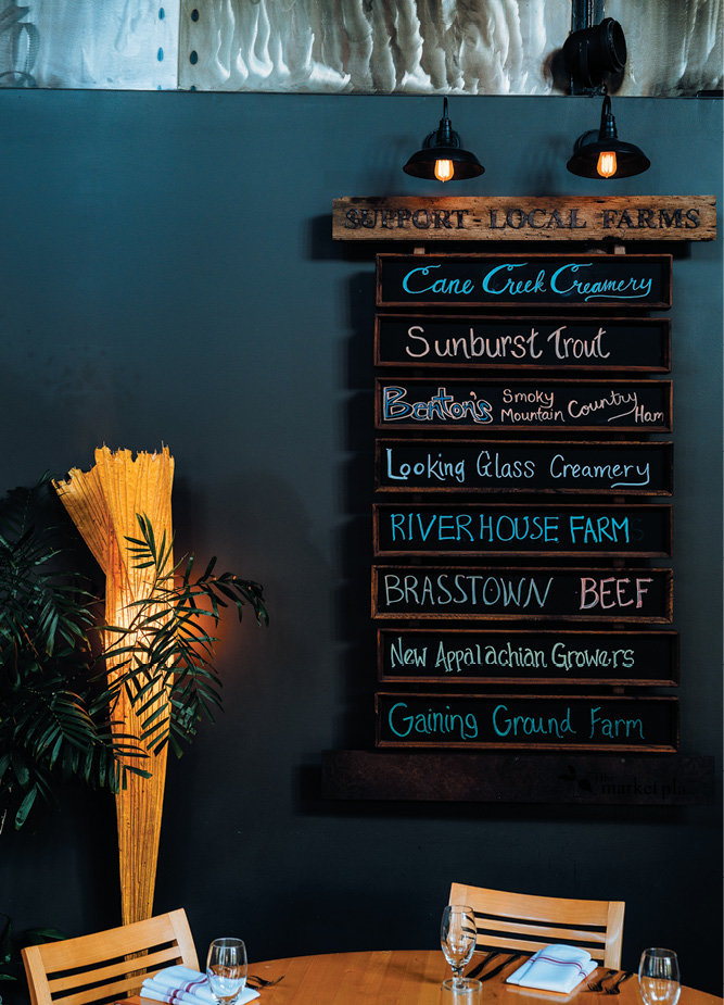At Dissen's restaurant, The Market Place, signage displays some of the regional farms, creameries, and other food producers where he gets his ingredients.