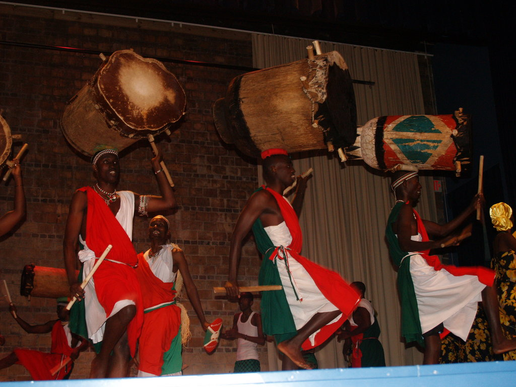 Dressed in the red, white, and green of the Burundian flag