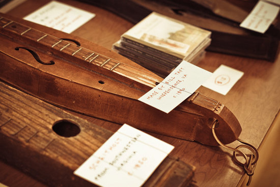 Handcrafted antique dulcimers on display in the History Center, including one made in 1890.