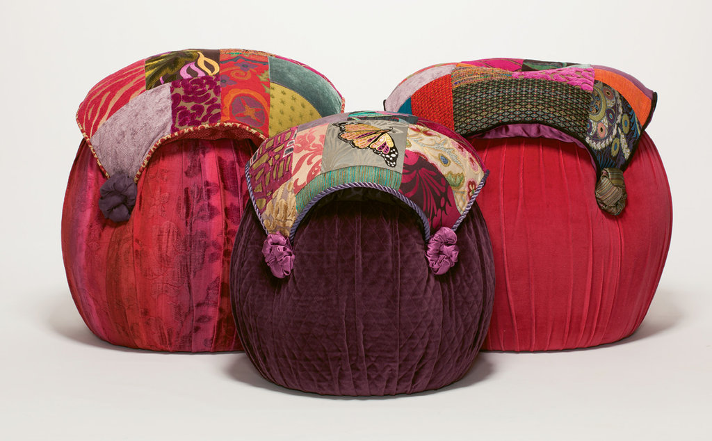 An array of richly patterned and contrasting fabrics add texture and intrigue to tuffets, settees, and chairs.