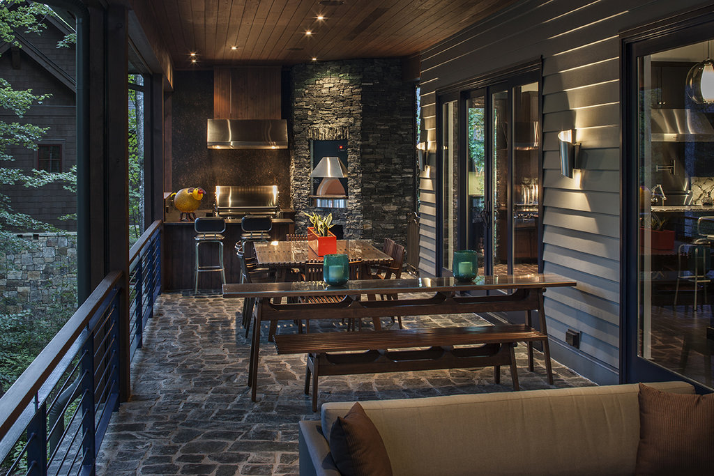 The long porch is a dream for entertaining, with an outdoor kitchen at the far end.