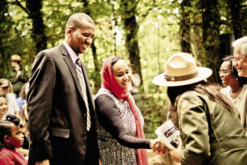a couple from Sudan received congratulations from immigration and park employees who run the ceremony.