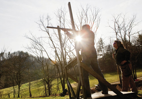 Averill works on his aim, moving the gun as if it were an extension of his body.