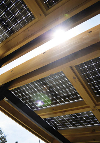 A solar canopy over the porch helps power the home.
