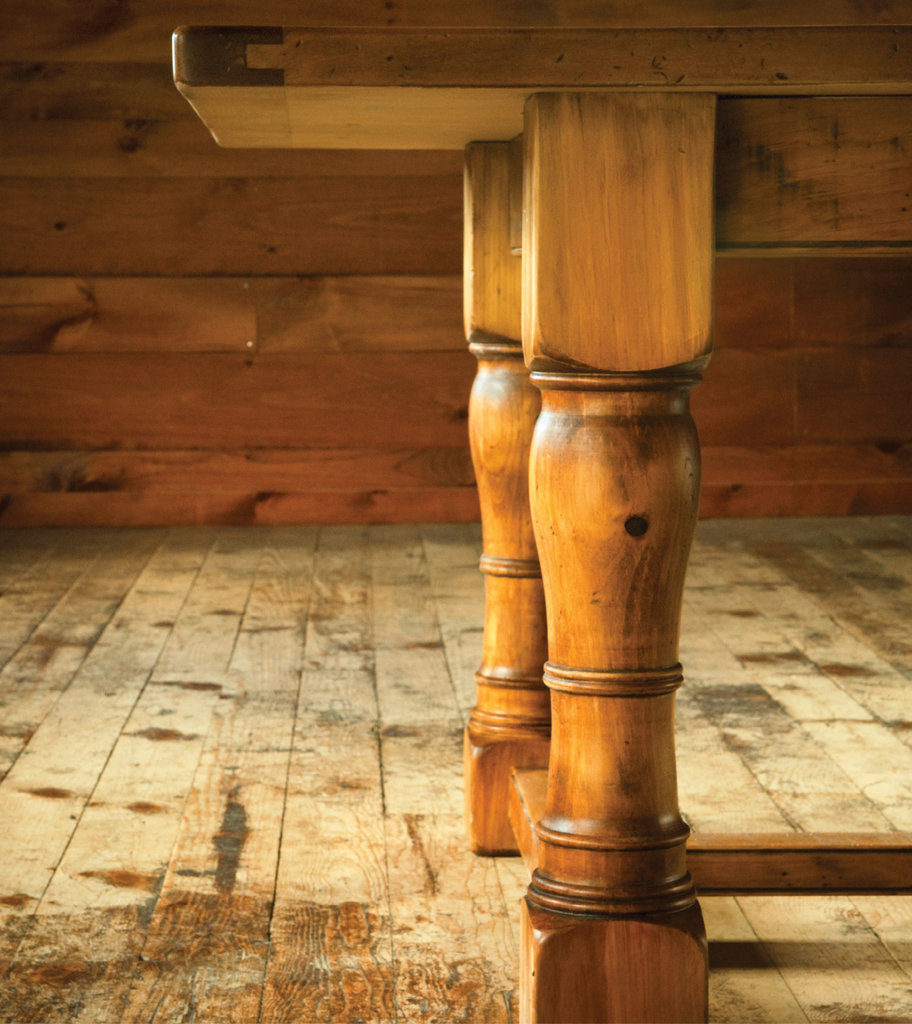 Carolina Farm Table crafts custom furnishings, including this Tavern Table made of stained pine, plus chairs, hutches, islands, and more.