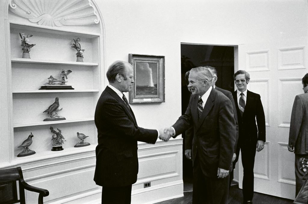 Duckett, who usually avoided the limelight, was photographed at the White House (below) while receiving an award from President Ford in 1974.