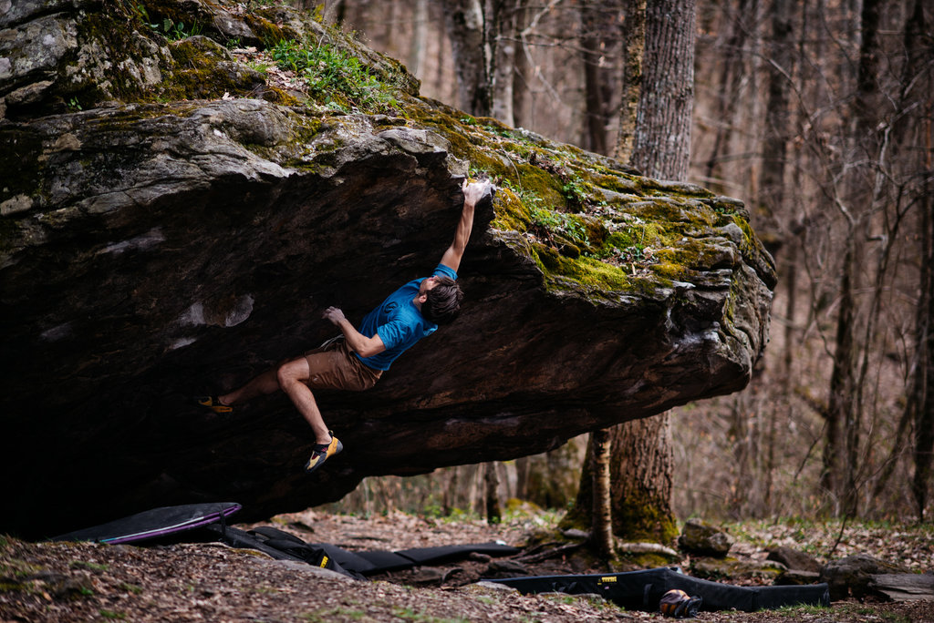 HONORABLE MENTION - LEAP - Andy Wickstrom - Asheville climber Josh Cooper on Corner Rock boulder outside of Barnardsville. Professional category