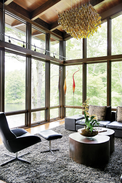 In the living room, it's hard to distract from the views, but key works of art—the blown glass sculptures, Italian chandelier, and coffee table made locally by Rob Sadler—draw the gaze inside.