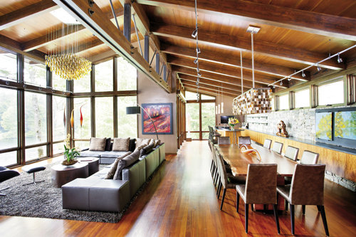 he open floor plan is great for large parties. The bar in the corner flows seamlessly into the dining and living room. Twelve can dine comfortably around the table by Brian Fireman.