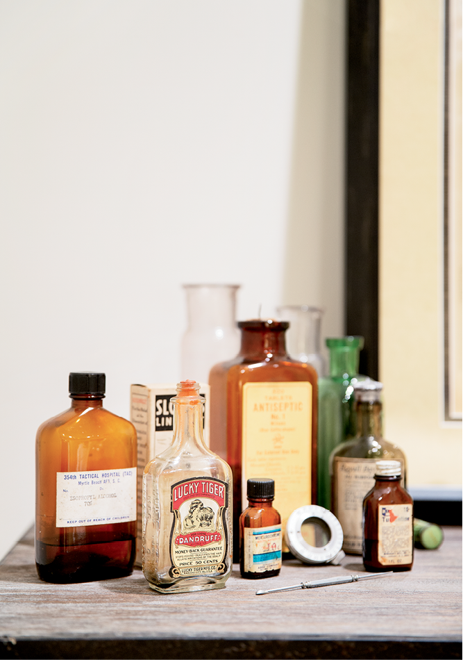 Old medicine bottles add intrigue to a shelf in the guest bathroom.