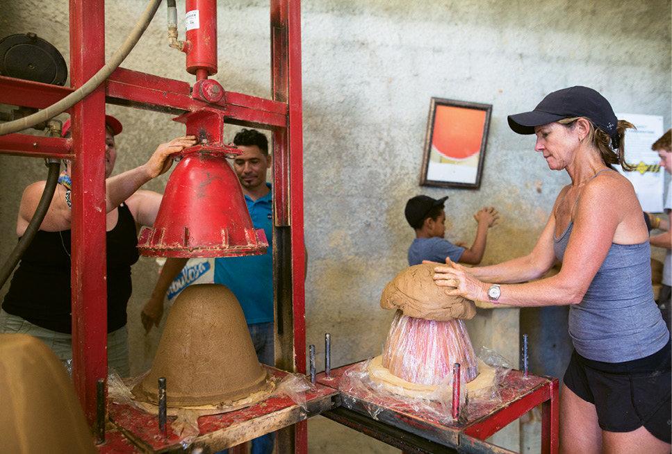 Volunteers help make ceramic filters in Dominican Republic.