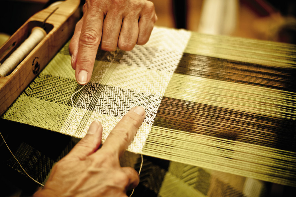 In the weaving studio, advanced students practice twill patterns on the looms.