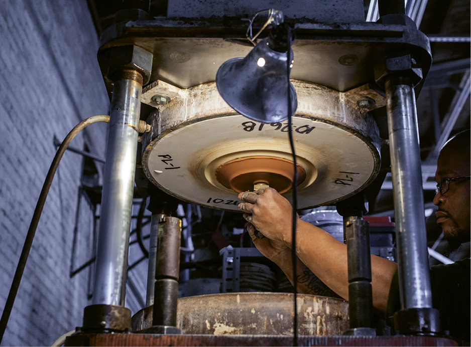 Though the increase in output required a departure from hand-throwing on a wheel, each piece produced still goes through many hands with the aid of modern machinery.