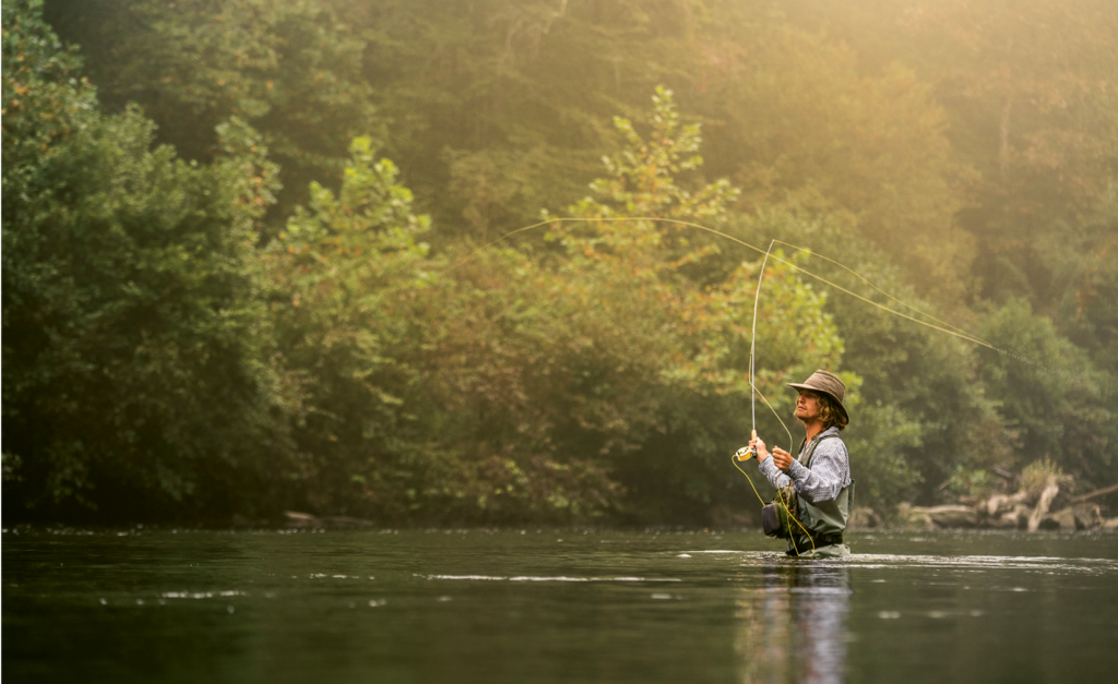 Brett Meany, a guide with Headwaters Outfitters, fishes a stretch of the French Broad River near its origin in Transylvania County.