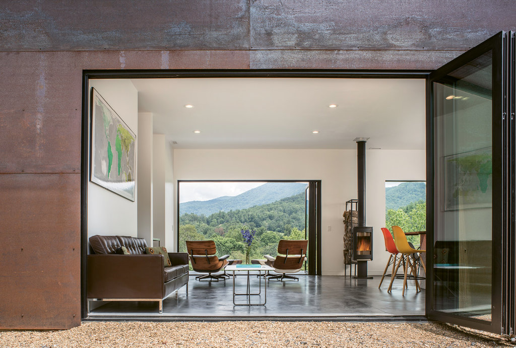 Scene Setters: Large accordion doors—the couples' biggest splurge on the project—open the entire space to the spectacular mountain surroundings.