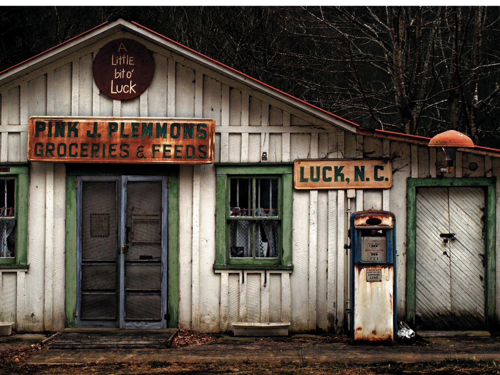FINALIST - A LITTLE BIT OF LUCK  - J.K. York -  The bygone Pink J. Plemmons Groceries & Feeds store in the tiny town of Luck had just the right character to motivate this shot.  Amateur category