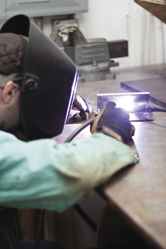 After bending the paper into intriguing forms, he welds metal components to cradle the shapes