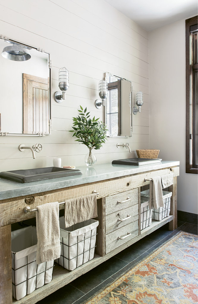 The master bathroom features a his-and-hers vanity built from reclaimed wood.
