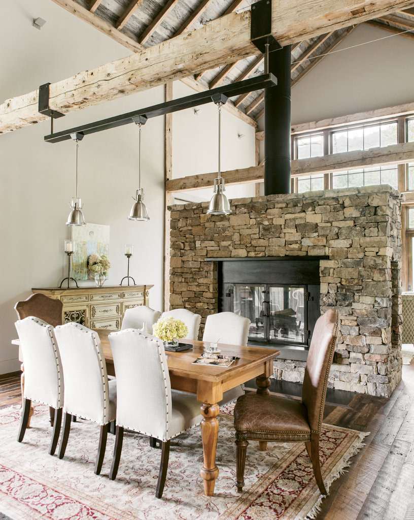 The two-sided fireplace serves as a partition between the dining and living spaces while still allowing light to flood in.