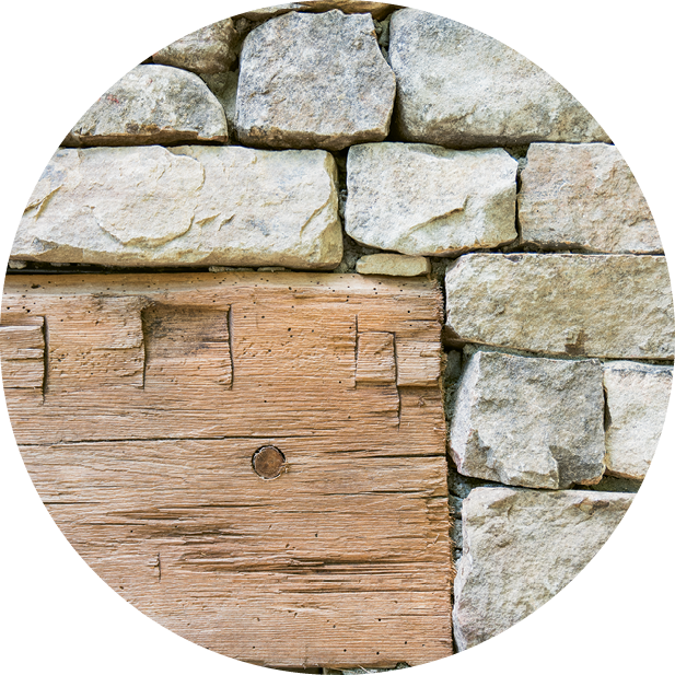 A reclaimed wooden lintel matches the original barnwood.