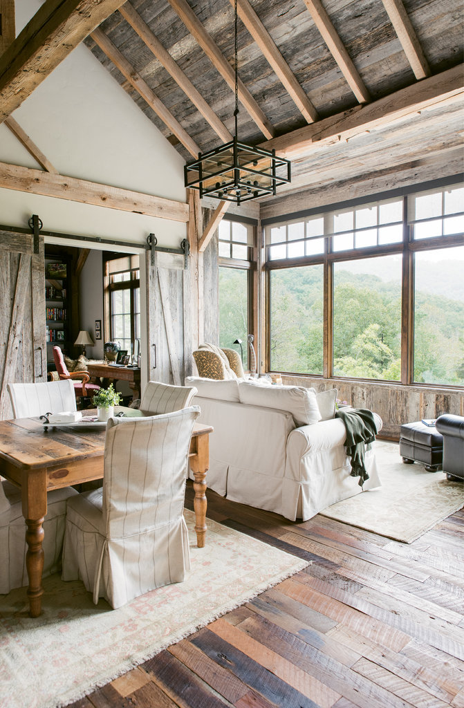 Reclaimed wood was used on the floors and other surfaces, including the sliding barn doors that separate the main floor living area from the office/library.