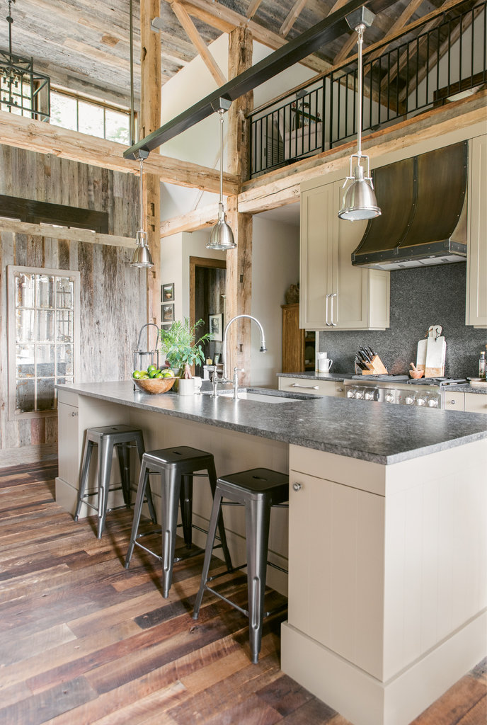 The kitchen, which features leathered granite countertops, invites mingling. A prep area and fridge are tucked around the corner.
