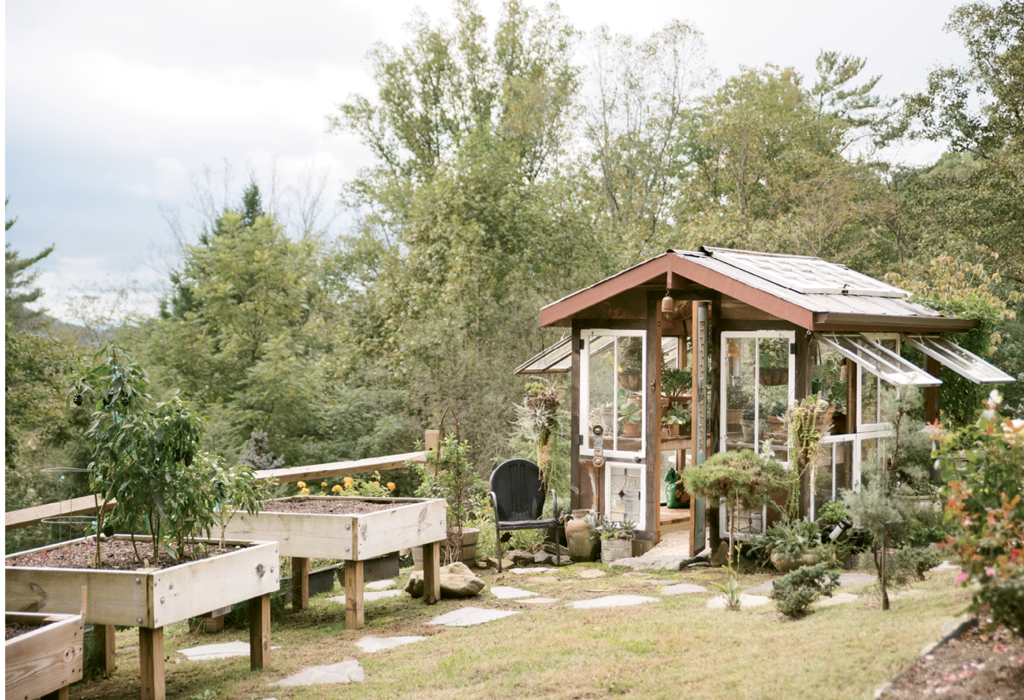 He homeowner designed the greenhouse and the extra-elevated garden beds, which were built with ease and convenience in mind.