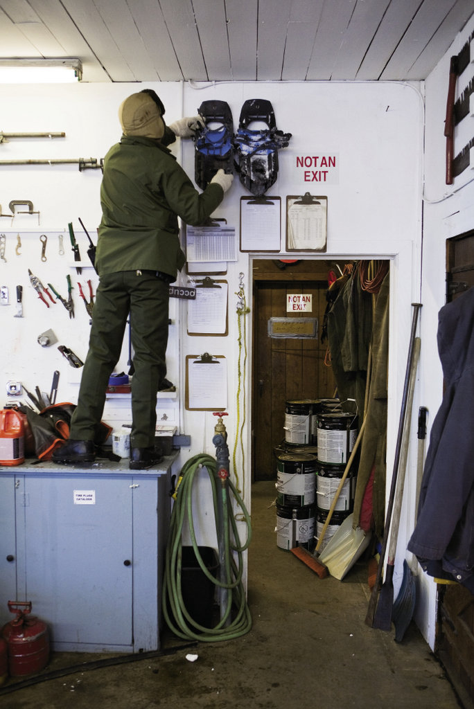 Matthew Brown reaches for the  essential gear of winter: snowshoes.