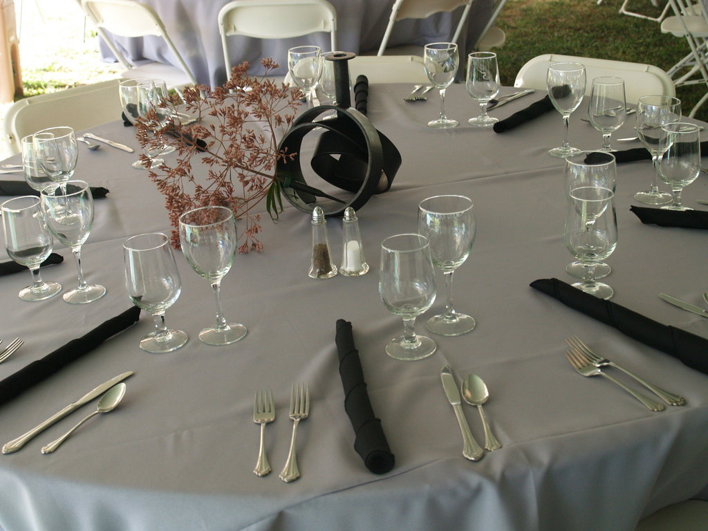 The tables are set with elegant centerpieces by Hoss Haley