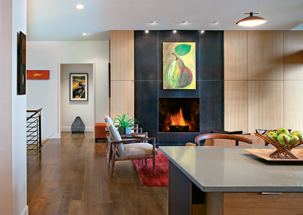 The fireplace was resurfaced with steel panels and white oak cabinets were added.