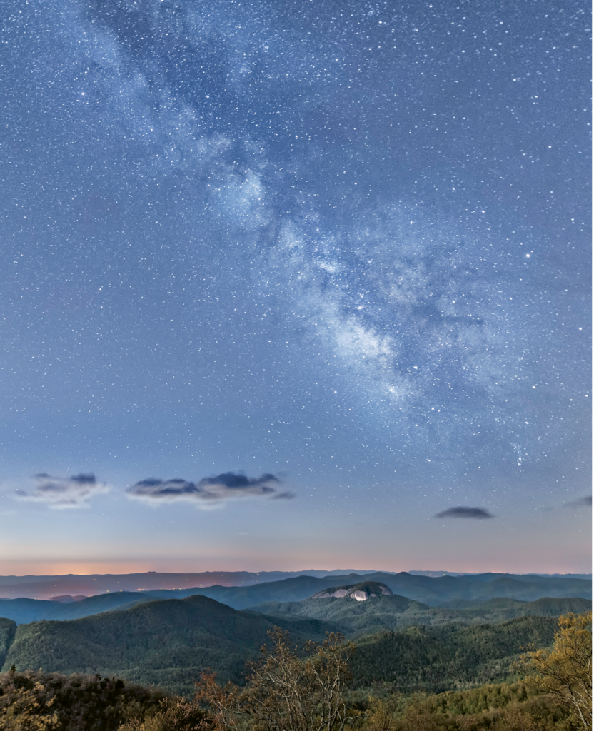 FINALIST - LOOKING GLASS AT NIGHT - Kathryn Greven - From Pounding Mills overlook on the Blue Ridge Parkway, Greven shot this  image at 3 a.m.,  using several exposures to capture the brilliance of the Milky Way over Looking Glass Rock.  Amateur category